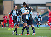 Luke O'Nien of Wycombe Wanderers, Garry Thompson of Wycombe Wanderers and Aaron Amadi Holloway of Wycombe Wanderers celebrates as Stephane Zubar of York scores an OG during the Sky Bet League 2 match between Wycombe Wanderers and York City at Adams Park, High Wycombe, England on 8 August 2015. Photo by Andy Rowland.