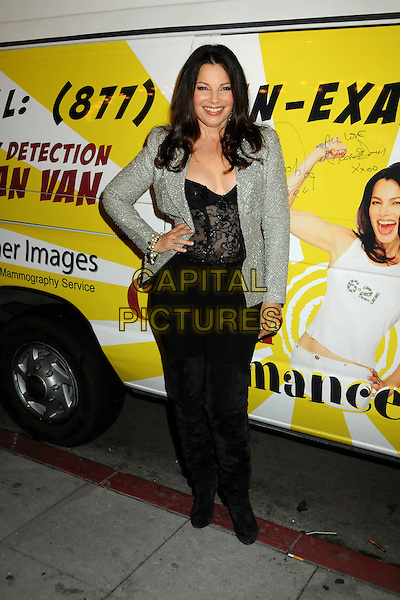 "FRAN DRESCHER .""The Million Dollar Revival"" Benefit for Fran Drescher's Cancer Schmancer Charity Movement held at the Million Dollar Theatre, Los Angeles, California, USA..December 13th, 2009.full length black grey gray jacket top corset lace jeans denim hand on hip silver thigh high boots jewel encrusted embellished sparkly.CAP/ADM/BP.©Byron Purvis/AdMedia/Capital Pictures."