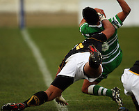 Wellington number eight Matthew Luamanu high tackles Aaron Smith during the Air NZ Cup preseason match between Manawatu Turbos and Wellington Lions at FMG Stadium, Palmerston North, New Zealand on Friday, 17 July 2009. Photo: Dave Lintott / lintottphoto.co.nz