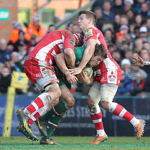 16.02.2014 Leicester, England. Leicesters Anthony Allen goes throughgh the gap during the Aviva Premiership game between Leicester Tigers and Gloucester Rugby from Welford Road Stadium.