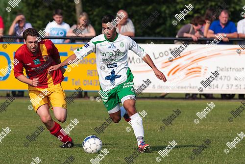 2013-07-06 / Voetbal / Seizoen 2013-2014 / Galamatch/ KSK Retie-KFC Dessel Sport/ Alias Ba (r.Dessel Sport) in duel met Joachim van Reeth (l. Retie)<br /> <br /> Foto: Mpics.be