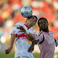24 June2009: New York Red Bulls forward Juan Pablo Angel # 9 and Toronto FC defender Adrian Serioux #15 in action at BMO Field in Toronto, in a game between the New York Red Bulls and Toronto FC. Toronto FC won 2-0..