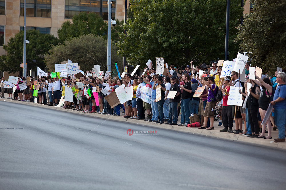 The Occupy Wall Street protests have spread from New York City to Austin, Texas. Hundreds of Occupy Austin protesters pumped their fists and raised hand-drawn signs condemning Wall Street greed at this morning's protest at Austin City Hall Headquarters.