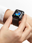 Woman hand with Apple Watch smartwatch on her wrist on white background