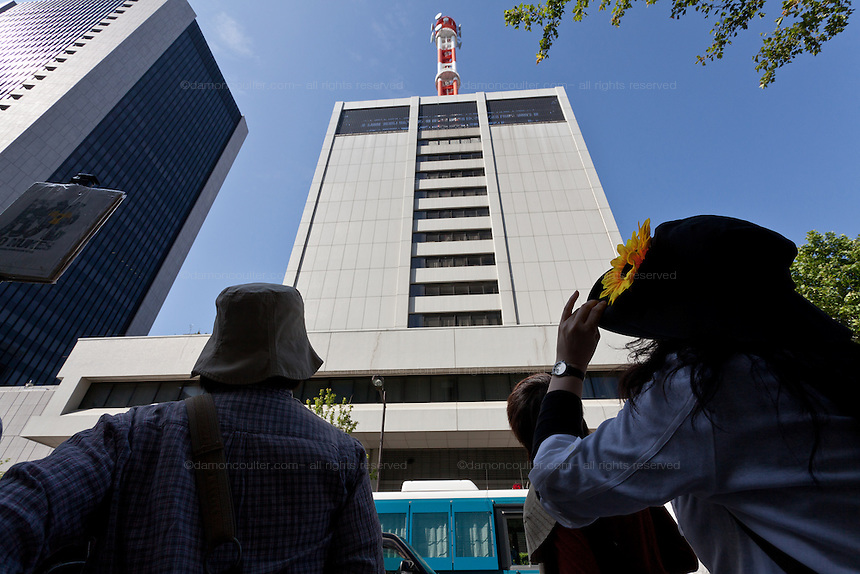 Anti nuclear protesters march past the headquarters of Tokyo Electric Company (TEPCO) in  Ushisaiwaicho, Tokyo, Japan Sunday June 2nd 2013