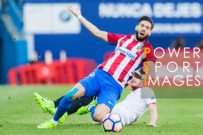 Yannick Ferreira Carrasco (l) of Atletico de Madrid gets tripped by Sergio Escudero Palomo of Sevilla FC during their La Liga match between Atletico de Madrid and Sevilla FC at the Estadio Vicente Calderon on 19 March 2017 in Madrid, Spain. Photo by Diego Gonzalez Souto / Power Sport Images