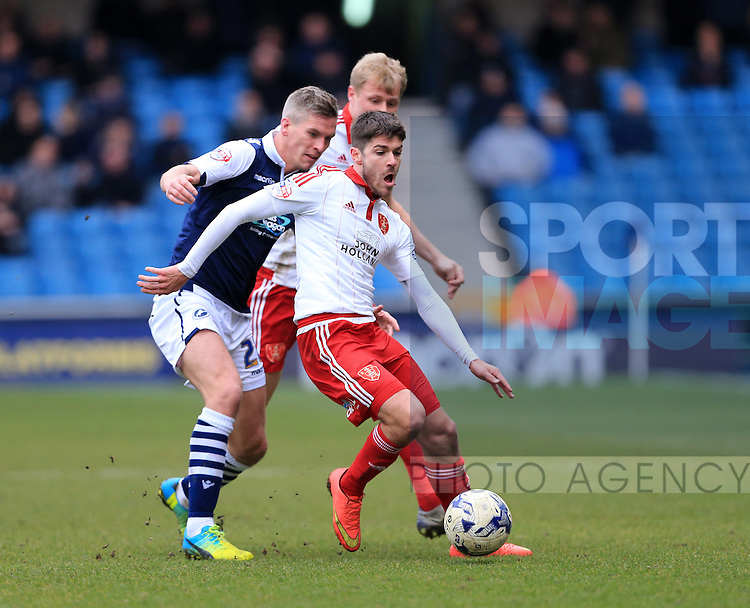 Millwall's Steve Morison tussles with Sheffield United's Ryan Flynn during the League One match at The Den.  Photo credit should read: David Klein/Sportimage