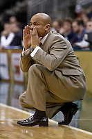 February 03, 2011:    Jacksonville Dolphins head coach Cliff Warren call out a play during Atlantic Sun Conference action between the Jacksonville Dolphins and the Belmont Bruins at Veterans Memorial Arena in Jacksonville, Florida.  Belmont defeated Jacksonville 76-70.