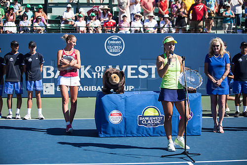 09.08.2015. Stanford, California, USA.  Angelique Kerber (GER) (right) addresses the crowd after being awarded the 2015 Bank of the West Classic Championship at Stanford University's Taube Family Tennis Center in Stanford, Calif.