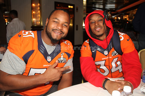 JERSEY CITY, NJ - JANUARY 29:  Jeremy Mincey, Marquice Cole attending the Denver Broncos press conference at the Cornucopia Majesty ship at the Hyatt in Jersey City, New Jersey on January 29, 2014. Photo Credit: Walik Goshorn/MediaPunch.