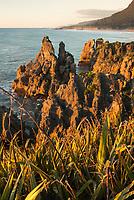 Sunset over limestone formations at Pancake Rock, Paparoa National Park, Punakaiki, Buller Region, West Coast, New Zealand, NZ