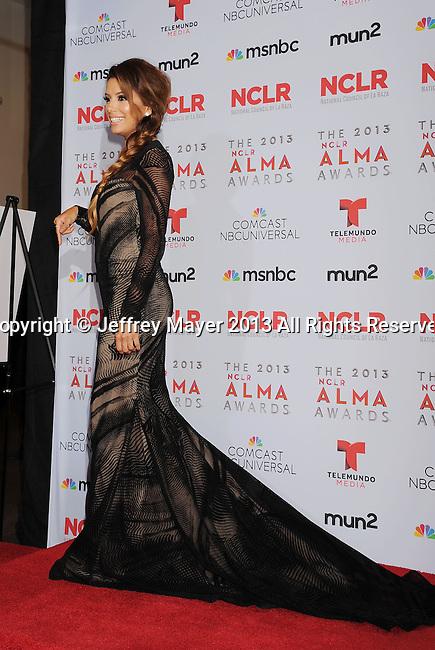 PASADENA, CA- SEPTEMBER 27: Actress Eva Longoria poses in the press room at the 2013 NCLA ALMA Awards at Pasadena Civic Auditorium on September 27, 2013 in Pasadena, California.