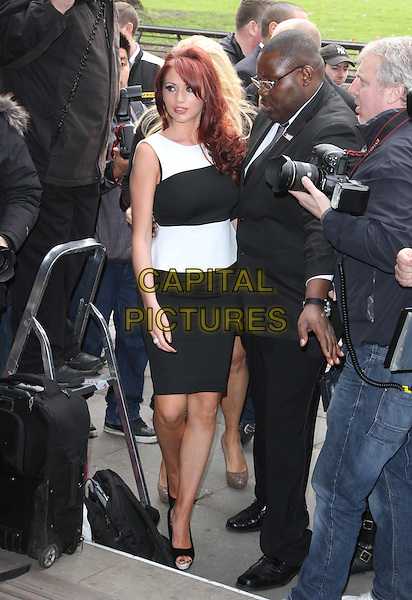 Amy Childs.The TRIC ( TV & Radio Industries Club ) Awards, Grosvenor House Hotel, Park Lane, London, England..13th March 2012.full length dress black white peplum sleeveless minder bodyguard security .CAP/ROS.©Steve Ross/Capital Pictures