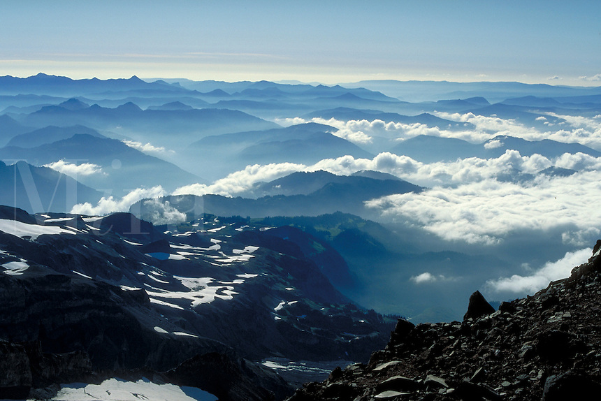 Misty mountain ranges seen from high on Mt Rainier, in the vicinity of Camp Muir at 10,000 foot elevation. Mt Rainier WA USA Near Camp Muir.