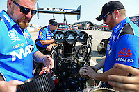 Sept. 22, 2012; Ennis, TX, USA: NHRA crew members for top fuel dragster driver Brandon Bernstein change the blower drive pulley during qualifying for the Fall Nationals at the Texas Motorplex. Mandatory Credit: Mark J. Rebilas-