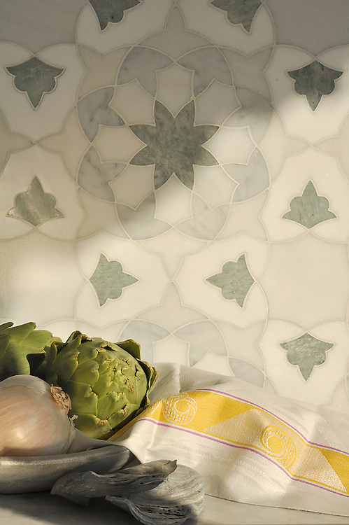 Alcala, a natural stone waterjet mosaic shown in honed Heavenly Cream, polished Carrara, Ming Green, and Thassos, is part of the Miraflores collection by Paul Schatz for New Ravenna.