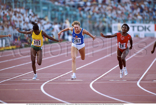 287. HEIKE DRECHSLER (GDR) finishes second behind 403. Merlene Ottey (JAM), Women's 100m Final, World Athletics Championships, Rome 1987 Photo:Richard Francis/Action Plus...1987.Finish Line.sprint.sprinter.sprinting.woman.track and field.female