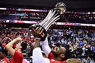 Washington, DC - MAR 11, 2018: Davidson Wildcats forward Nathan Ekwu (1) celebrates with the trophy after winning the Atlantic 10 men's basketball championship over Rhode Island at the Capital One Arena in Washington, DC. (Photo by Phil Peters/Media Images International)