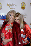 CONNIE STEVENS, NANCY SINATRA. Arrivals to A Tribute to the USO, a musical and video tribute to seven decades of USO service at the Saban Theatre. Beverly Hills, CA, USA. February 21, 2010.
