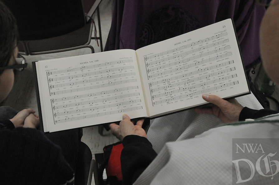 NWA Democrat-Gazette/FLIP PUTTHOFF <br /> Sacred Harp music has its own system    Saturday Oct. 24, 2015   of notes. The singing is voices only with no piano or other instruments. Singers are encouraged to sing out with enthusiasm for the joy of singing and not to entertain an audience.