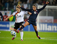 Carli Lloyd (10) tries to steal the ball Kim Kulig (14). US Women's National Team defeated Germany 1-0 at Impuls Arena in Augsburg, Germany on October 27, 2009.