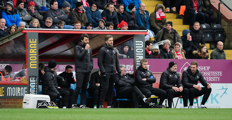 Lincoln City manager Danny Cowley, left, and Lincoln City's assistant manager Nicky Cowley watch on from the technical area<br /> <br /> Photographer Chris Vaughan/CameraSport<br /> <br /> The EFL Sky Bet League Two - Lincoln City v Grimsby Town - Saturday 19 January 2019 - Sincil Bank - Lincoln<br /> <br /> World Copyright &copy; 2019 CameraSport. All rights reserved. 43 Linden Ave. Countesthorpe. Leicester. England. LE8 5PG - Tel: +44 (0) 116 277 4147 - admin@camerasport.com - www.camerasport.com