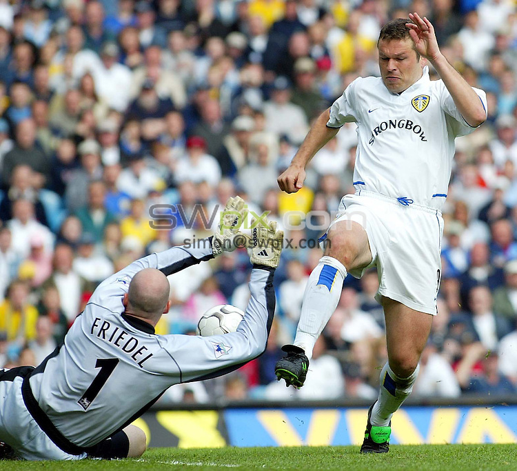 Pix, Shaun Flannery/SWpix. Barclaycard Premiership..Leeds United v Blackburn Rovers, 26/4/2003...COPYRIGHT PICTURE>>SIMON WILKINSON>>01943 - 436649>>..Mark Viduka's effort is saved by Blackburn's Brad Friedel.