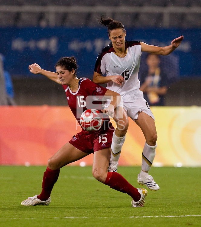USWNT defender (15) Kate Markgraf fights for the ball with Canadian forward (15) Kara Lang while playing at Shanghai Stadium.  The US defeated Canada, 2-1, in extra time and advanced to the semifinals during the 2008 Beijing Olympics in Shanghai, China.  hai, China.