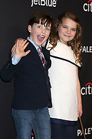 "LOS ANGELES - MAR 21:  Iain Armitage, Raegan Revord at the 2018 PaleyFest Los Angeles - ""Big Bang Theory, Young Sheldon"" at Dolby Theater on March 21, 2018 in Los Angeles, CA"