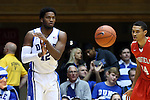15 November 2014: Duke's Justise Winslow (12) and Fairfield's Marcus Gilbert (14). The Duke University Blue Devils hosted the Fairfield University Stags at Cameron Indoor Stadium in Durham, North Carolina in an NCAA Men's Basketball exhibition game. Duke won the game 109-59.