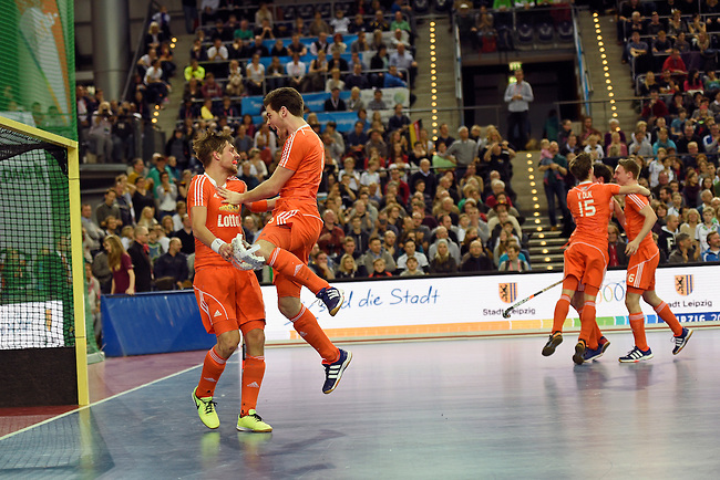 Leipzig, Germany, February 08: (L-R) Bjoern Kellermann #9 of The Netherlands and Lars Balk #6 of The Netherlands celebrate after defeating Austria 3-2 to win the FIH Indoor Hockey Men World Cup on February 8, 2015 at the Arena Leipzig in Leipzig, Germany. (Photo by Dirk Markgraf / www.265-images.com) *** Local caption ***