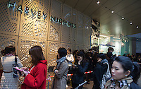Luxury shoppers wait in line to get into the Hong Kong branch of Harvey Nichols, a British department store that sells luxury products, Hong Kong, China, 07 March 2014. Hong Kong is known as a shopping mecca for luxury goods due to the fact that such goods are sold tax free in the ex-British colony, in contrast to mainland China where high taxes are still slapped on luxury goods.