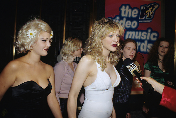 Drew Barrymore and Courtney Love pictured at the MTV Video Awards in New York City on September 7, 1995.  © Scott Weiner /MediaPunch.