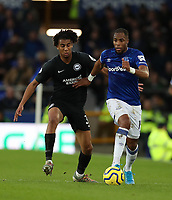 11th January 2020; Goodison Park, Liverpool, Merseyside, England; English Premier League Football, Everton versus Brighton and Hove Albion; Djibril Sidibe of Everton runs with the ball chases by Solly March of Brighton and Hove Albion - Strictly Editorial Use Only. No use with unauthorized audio, video, data, fixture lists, club/league logos or 'live' services. Online in-match use limited to 120 images, no video emulation. No use in betting, games or single club/league/player publications