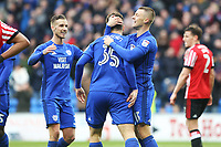 Anthony Pilkington of Cardiff City celebrates scoring his sides fourth goal of the match with Yanic Wildschut during the Sky Bet Championship match between Cardiff City and Sunderland at the Cardiff City Stadium, Wales, UK. Saturday 13 January 2018