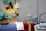 Dentist works on a tourist patient in Los Algodones, B.C, Mexico.