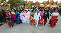 NWA Democrat-Gazette/BEN GOFF @NWABENGOFF<br /> Dancers with Latin Art Organization of Northwest Arkansas wearing costumes representing various latin cultures lead a procession Friday, Nov. 2, 2018, during a Dia de los Muertos celebration from Shiloh Square to the Arts Center of the Ozarks in downtown Springdale.
