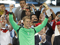Goalkeeper Manuel Neuer of Germany lifts his Golden Glove trophy