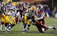 NWA Media/ANDY SHUPE - Arkansas' Martrell Spaight, right, causes LSU's Anthony Jennings (10) to fumble the ball during the fourth quarter Saturday, Nov. 15, 2014, at Razorback Stadium in Fayetteville.