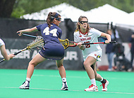 College Park, MD - May 19, 2018: Maryland Terrapins Kali Hartshorn (16) and Navy Jenna Collins (44) faceoff during the quarterfinal game between Navy and Maryland at  Field Hockey and Lacrosse Complex in College Park, MD.  (Photo by Elliott Brown/Media Images International)