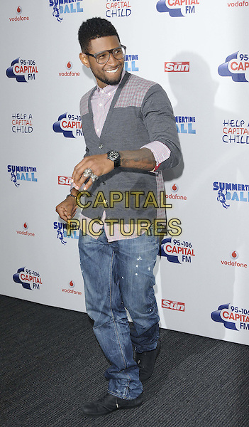 Usher (Usher Raymond).attended the Capital Radio FM Summertime Ball, Wembley National Stadium, Wembley, London, England, 9th June 2012..arrivals full length glasses grey gray cardigan red checked plaid shirt beard facial hair jeans hand wrist watch rings .CAP/CAN.©Can Nguyen/Capital Pictures.