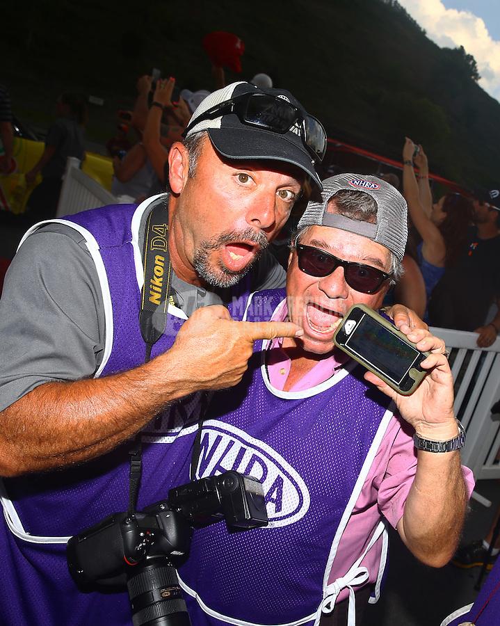 Jun 20, 2015; Bristol, TN, USA; NHRA photographers Gary Nastase (left) and Richard Shute during the Thunder Valley Nationals at Bristol Dragway. Mandatory Credit: Mark J. Rebilas-