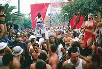 Spain. Ibiza in the Balearic islands. Ibiza. Disco Amnesia. The day after a night of party. End of a special gay evening. Homosexual men dance together on the sound of techno music.  © 1999 Didier Ruef