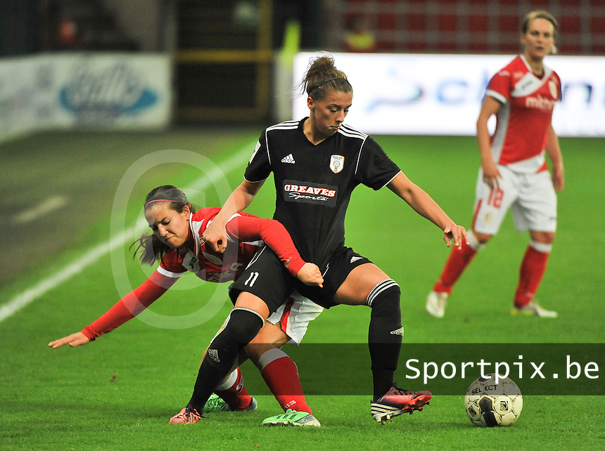 20131009 - LIEGE , BELGIUM : duel  pictured between Standard's Vanity Lewerissa (left) and Glasgow Nicola Docherty during the female soccer match between STANDARD Femina de Liege and  GLASGOW City LFC , in the 1/16 final ( round of 32 ) first leg in the UEFA Women's Champions League 2013 in stade maurice dufrasne - Sclessin in Liege. Wednesday 9 October 2013. PHOTO DAVID CATRY