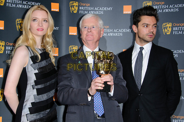 TALULAH RILEY, TIM CORRIE (Chairman of the Academy) & DOMINIC COOPER.The nominations for The Orange British Academy Film Awards (BAFTAs) at BAFTA headquarters, London, England..January 18th, 2011.half tie length black grey gray dress suit blue tie trophy award sleeveless.CAP/CJ.©Chris Joseph/Capital Pictures.