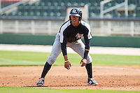 Luis Marte (13) of the Hickory Crawdads takes his lead off of first base against the Kannapolis Intimidators at CMC-Northeast Stadium on April 9, 2014 in Kannapolis, North Carolina.  The Intimidators defeated the Crawdads 1-0.  (Brian Westerholt/Four Seam Images)