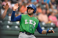 Third baseman Emmanuel Rivera (7) of the Lexington Legends is greeted after scoring a run in a game against the Greenville Drive on Friday, June 30, 2017, at Fluor Field at the West End in Greenville, South Carolina. Lexington won, 17-7. (Tom Priddy/Four Seam Images)