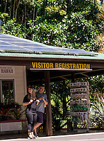 Visitors at the visitor registration sign and gift shop of the Hawaii Tropical Botanical Garden, Papa'ikou, Big Island of Hawaiʻi.