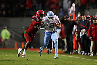 RALEIGH, NC - NOVEMBER 30: Dyami Brown #2 of the University of North Carolina is chased by Malik Dunlap #24 of North Carolina State University during a game between North Carolina and North Carolina State at Carter-Finley Stadium on November 30, 2019 in Raleigh, North Carolina.