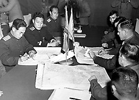 Col. James Murray, Jr., USMC, and Col. Chang Chun San, of the North Korean Communist Army, initial maps showing the north and south boundaries of the demarcation zone, during the Panmunjom cease fire talks.  October 11, 1951. F. Kazukaitis. (Navy)<br /> NARA FILE #:  080-G-437021<br /> WAR & CONFLICT BOOK #:  1516